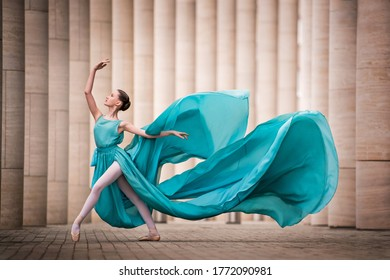 dancer in flying emerald dress