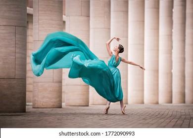dancer in flying emerald dress