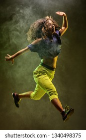dancer girl jumping, smoke in the background
