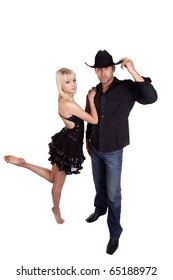 A dancer hanging on to her cowboy in his black hat.
