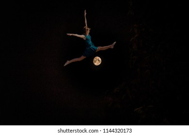 Dancer jumping over the moon: Conceptual photography photo