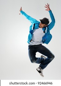 dancer jumps into the air and holds a pose, motion, movement and emotion all captured in this image
