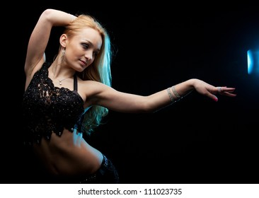 Dancer. Oriental dance. High contrast. Sensual movement
