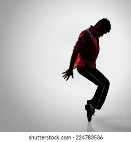 dancer performing freeze move on the toes. studio shot