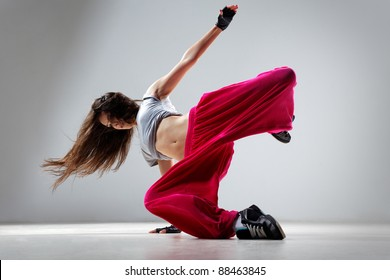 dancer posing on studio background