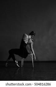 dancer sitting on a chair