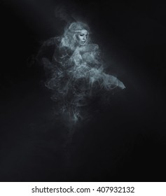 Dancer from smoke on the dark background