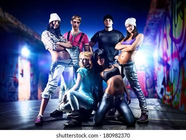 Dancer team on night urban background.