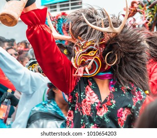 "Dancer wearing a devil costume at the ecuadorian festival ""Diablada Pillareña"""