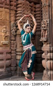 Dancer wears traditional costume and performs Odissi dance at Mukteshvara Temple,Bhubaneswar, Odisha, India