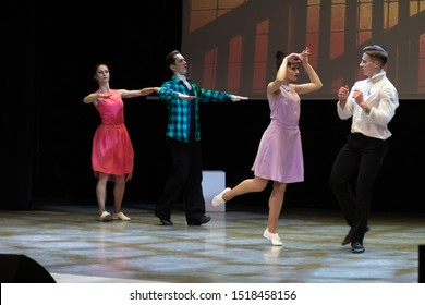 Dancers actors perform in the theater on stage in a dance show