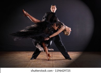 The dancers in ballroom, isolated on black background