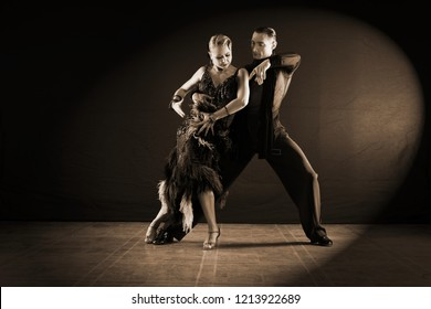 dancers in ballroom isolated on black background