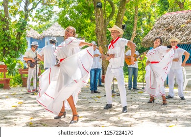 Dancers in costumes and musicians perform traditional cuban folk dance. Cuba, spring 2018
