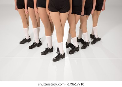 Dancers in fifth position in a wedge formation.