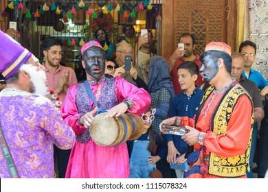 Dancers musicians with black face dance in the street in Bazaar to spread good cheer in Nowruz holidays. Shiraz. Iran