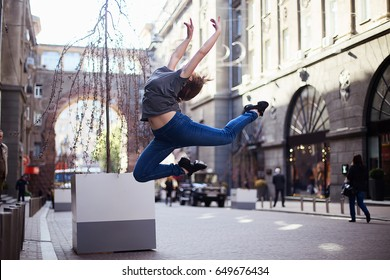 Dancers on the street, girl jumping and dancing on city streets