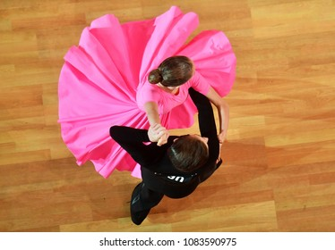 Dancers performing in a competition of ballroom dancing