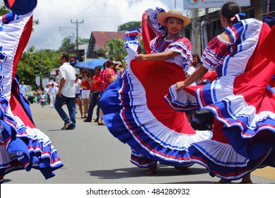 Dancers in traditional Costa Rican clothing the color of the nation's flag wow onlookers with traditional dances during the Independence Day parade in Quepos, Costa Rica, September 15, 2016