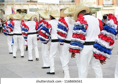 Dancers wearing one of the folk costume of Cuba ready to dance