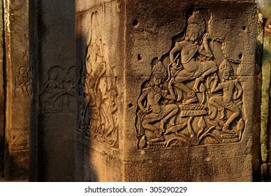 Dancing apsara devas on square columns of  Bayon Temple, Angkor Thom,  Cambodia