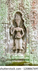 Dancing Apsaras an old Khmer art carvings on the wall.Vintage Culture and Religion Art.Guardian Angels at Angkor Wat. Seam Ream  Combodia.Photo select focus.