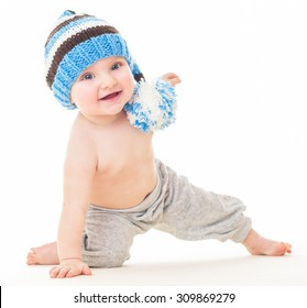 Dancing baby. cheerful baby in the hat. Beautiful happy baby . One,isolated on white. Laughing baby.