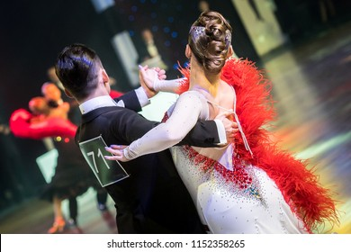 dancing ballroom couple in white dress on dance competition