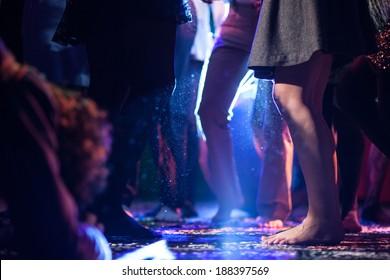 dancing barefoot on dance floor