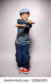 Dancing boy. Fashion mod child