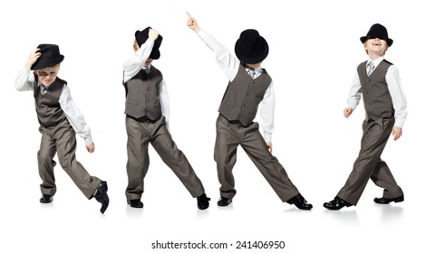Dancing boy in suit and hat isolated on white