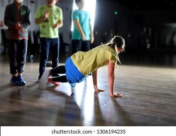 dancing breakdance girl in a dance battle