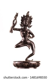 """The """"dancing"""" bronze figure Machig Labdron - the reincarnation of Yeshe Tsogyal in an active pose with a snare drum and a dorje in the crown."""