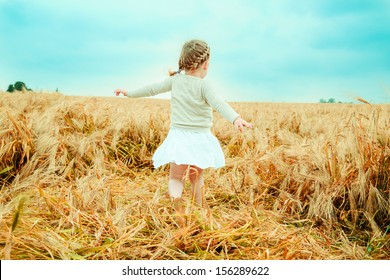 dancing child nostalgic in field