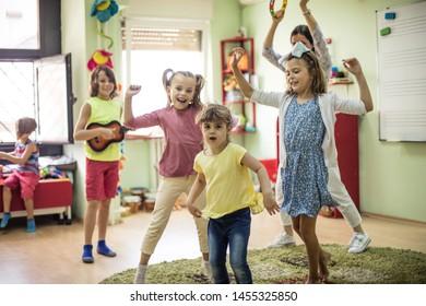 Dancing. Children playing in preschool.