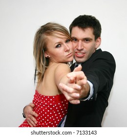 dancing couple shooting at you
