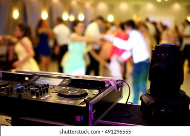 Dancing couples during party or wedding celebration by dj mixer