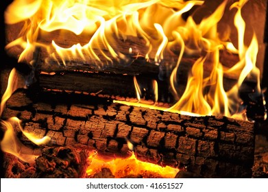 Dancing flames in a real woodburning fire in a woodburning stove.