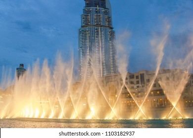 The Dancing Fountain of Dubai performs to the beat of the music at night show on lake area.