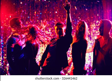 Dancing friends enjoying party in the night club