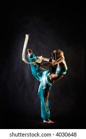 Dancing girl in fantasy Arabian harem costume