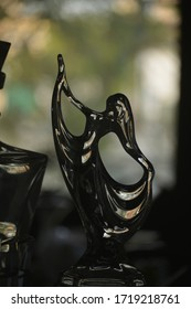 dancing girl, glass sculpture with a beautiful nature backdrop