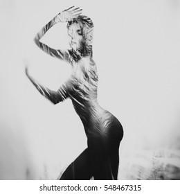 Dancing girl. Polyethylene film disco party. Fine-art photo. Tilt shift