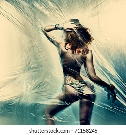 Dancing girl. Polyethylene film disco party. Art photo