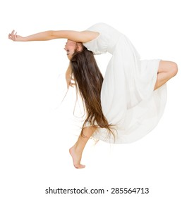Dancing girl in white dress isolated