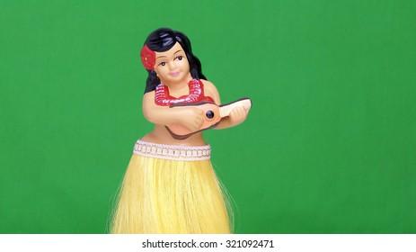 Dancing Hula girl doll against a green screen