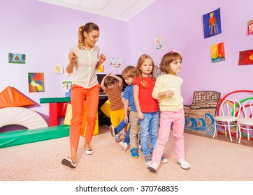 Dancing lesson with kids repeat after teacher