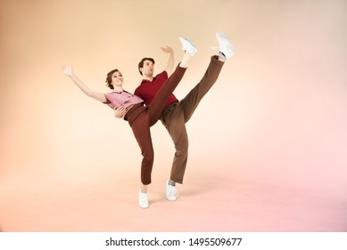 Dancing lindy hop couple in motion