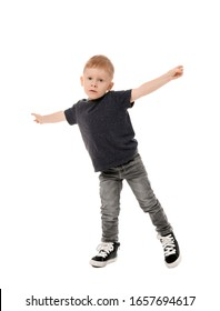 Dancing little boy on white background