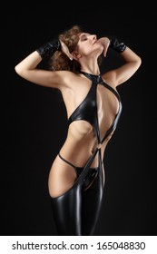 Dancing model dressed in clothes from latex. BDSM. Fetish